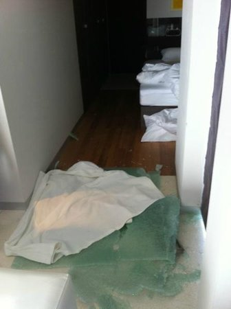 Infinity Residences & Resort Koh Samui: Shattered door, I had to place the towel over it to get to my bleeding wife