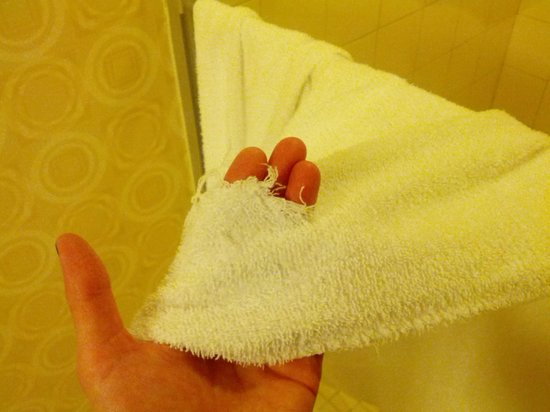 Planet Hollywood Resort & Casino: The holes in the towels were not small.