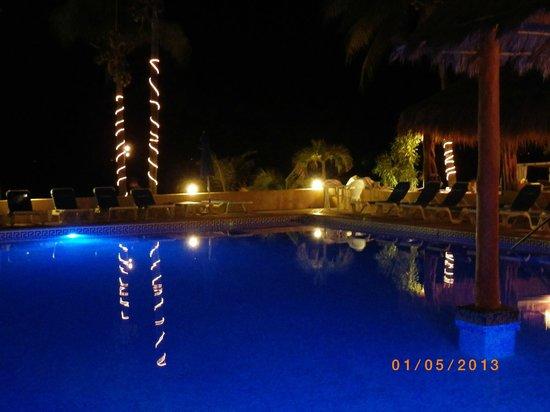 Nautibeach Condos: Looking across the pool at night