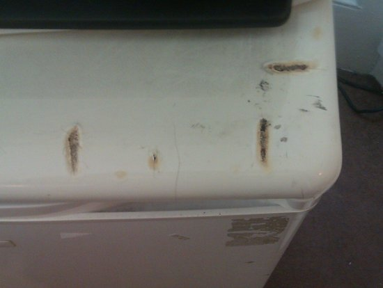 Aquarius Hotel: The fag burns on top of fridge