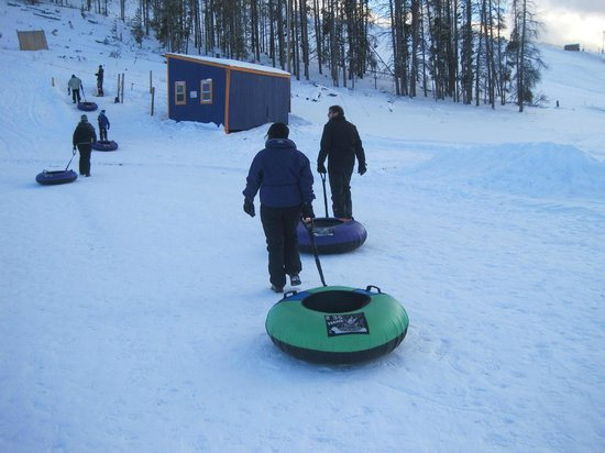 Fraser Tubing Hill: Dragging the tubes by their leashes to the pulley