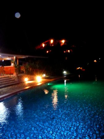 Finca Luna Nueva Lodge: the pool, restaurant and main lodge at night