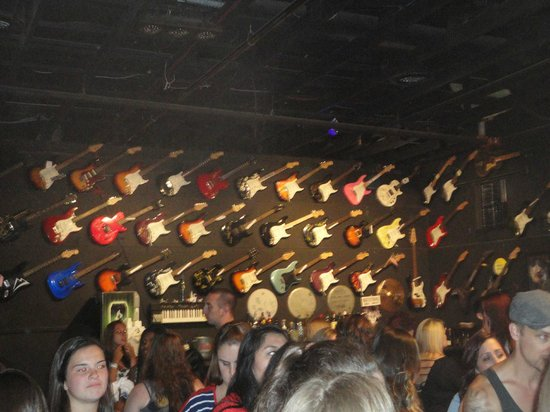 The Stone Pony: Guitar decorations on the wall.