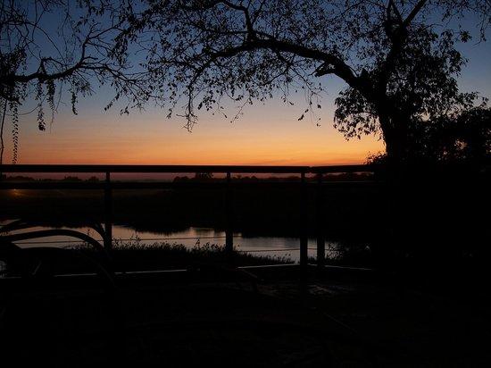 Ngwenya Lodge: balcony/outdoor dining area sunset