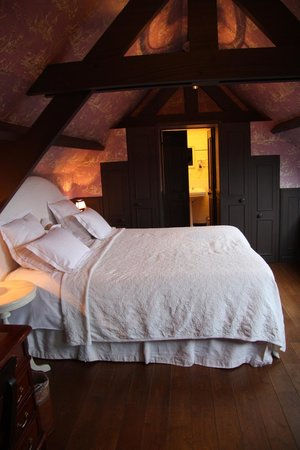 Hotel de Orangerie: The bedroom of the belfry room, looking into the closet
