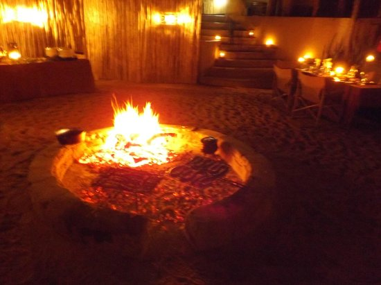 Simbavati River Lodge: Boers wors and pork cooking on open fire
