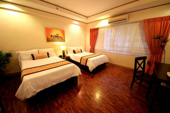 Casa Pura Inn and Suites: Double Twin Room