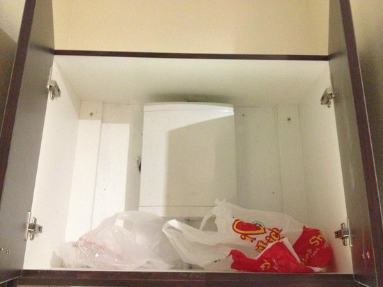 Hatten Hotel Melaka: Plastic bag found inside the cabinet above minibar counter