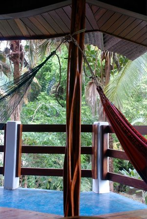 Encanta La Vida: Porch area that our room opened out to. Great place to relax, see/hear wildlife.