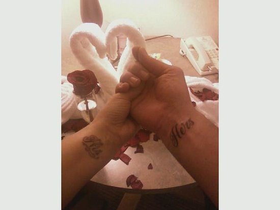 Inn at Seaside: our towel swans, rose petals and matching tattoos!