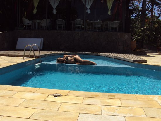 Pousada Le Palmier: Descanso en la piscina