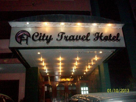 CITY TRAVEL HOTEL sign