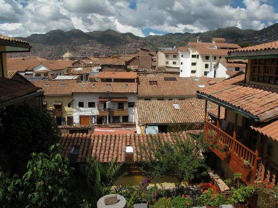 Amaru Hostal: View of Cuzco from the upper balcony, with courtyard below.