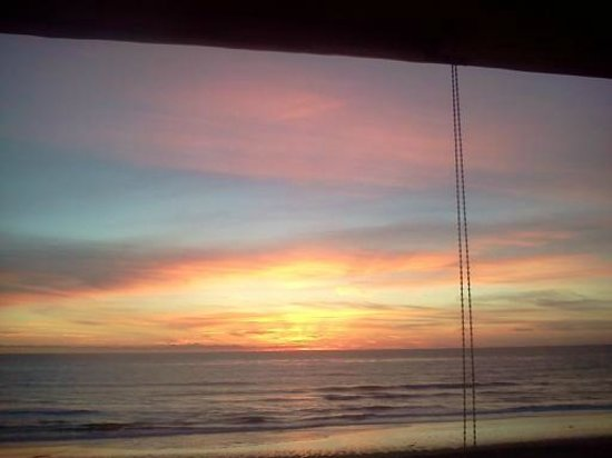Seashore on the Sand: This untouched photo of sunset from our balcony doesn't do it justice!