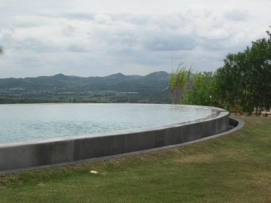 Sala Khaoyai: Curved Pool Against View