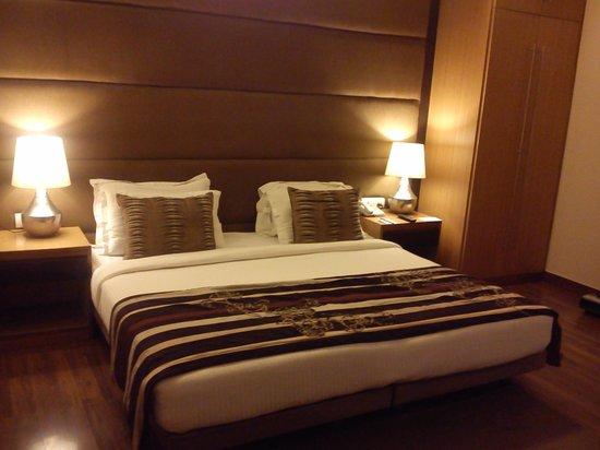 The Visaya: Bedroom with wooden floor.