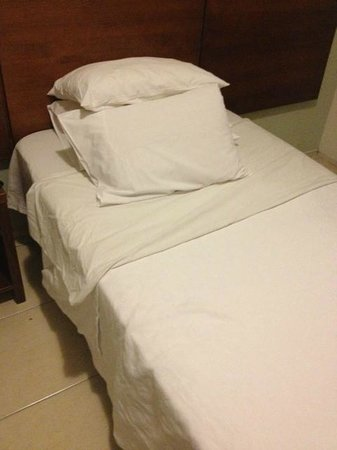 Copacabana Suites by Atlantica: this is the way the bed was made up by the hotel maid.