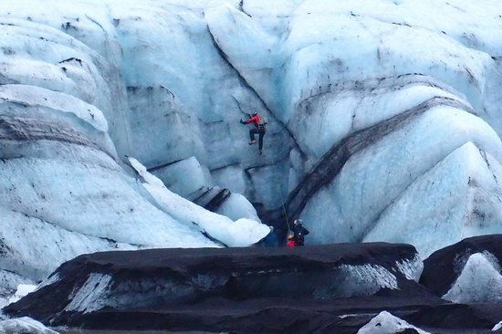 Iceland Horizon: Ice climbers on a Glacier you can walk on.