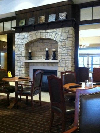 Sheraton Minneapolis Midtown Hotel: charming Fireplace and rustic decor at  SMM
