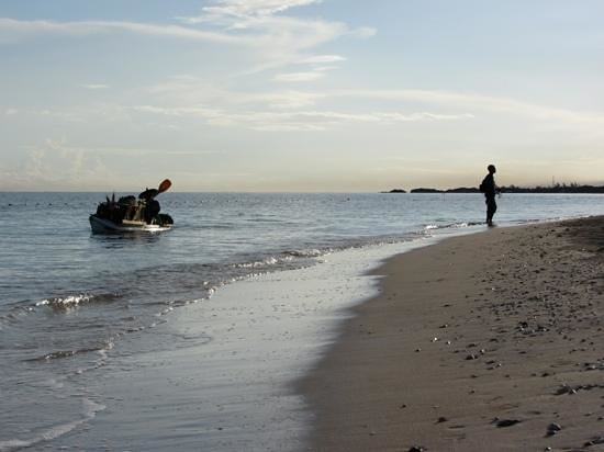 Iberostar Rose Hall Suites: Early morning seller, pitching his wares by kayak