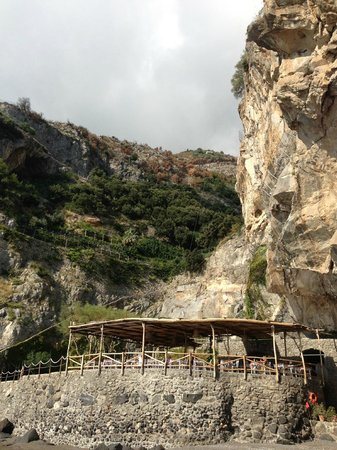 Il San Pietro di Positano: The beach side Cafe ~ The hotel is built into the cliff to the right!
