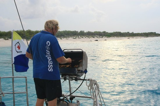 Compass Sailing: Wim grilling up some treats