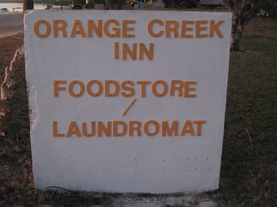 Orange Creek Inn: The sign welcoming you to the inn/foodstore/laundromat
