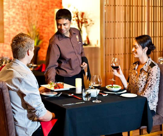 Sukra Restaurant at Lasseters Hotel Casino : Sukra waitstaff
