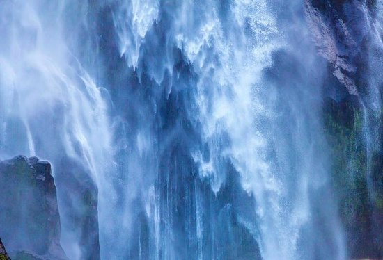 Milford Sound: Stirling Falls - then run for cover!