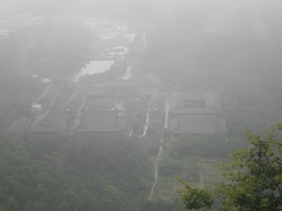 Jinshan Temple of Linchuan : high above the hill overlooking the local village below in the dense fog
