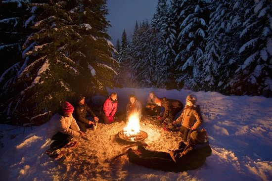 Oregon: Warming up around the fire on snowy Mt. Hood