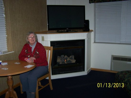 Cherry Tree Inn & Suites:                   playing cards by a cozy fire