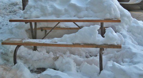 BEST WESTERN PLUS Tree House:                   picnic table outside of reception, covered in snow