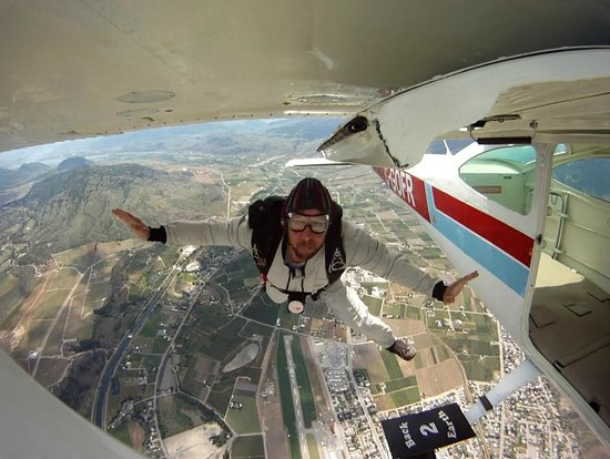 Skydiver exiting at 4000 feet above Skydive Oliver.