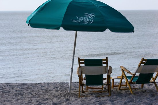 Tween Waters Inn Island Resort & Spa:                   Umbrellas and chairs- for a fee- on the beach