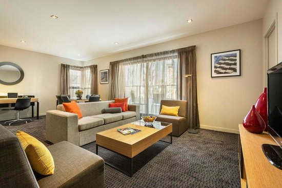 Quest Docklands: Two Bedroom Apartment, Open living area with balcony