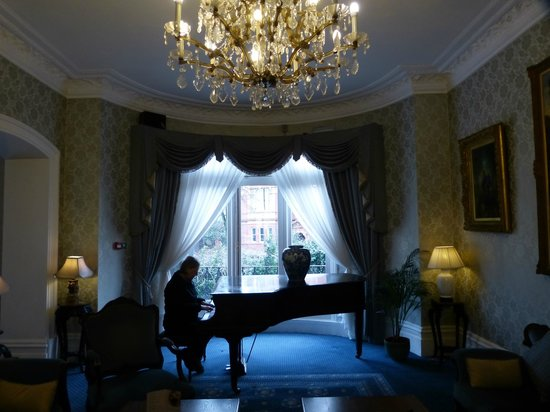 grand piano at window in living room area picture of best western rh tripadvisor co za
