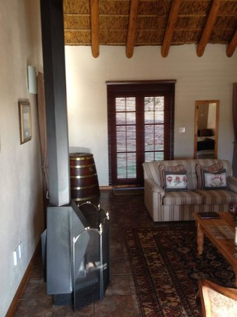 Orange Grove Farm : Lounge area with working fire place.