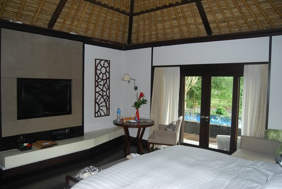 Pan Pacific Nirwana Bali Resort:                   2nd Bedroom villa 711, showing wall decorations and furnishings
