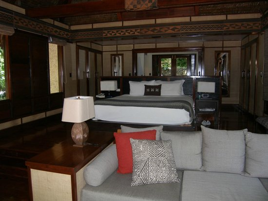 Likuliku Lagoon Resort:                   Our room, showing part of lounge area in front. Bathroom is at back.