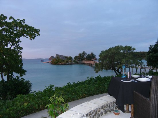 Likuliku Lagoon Resort:                   On lowest level of dining area at dusk, looking out to Island Bar.