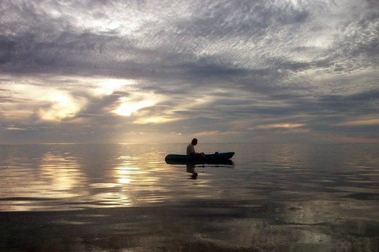 Aretai Beach Villas:                   Kayaking at dusk