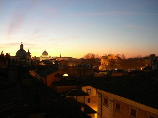 Hotel Genio:                   Dusk of the vatican from the rooftop terrace