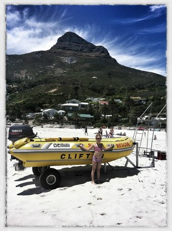 Clifton Beaches: Maja infront of surf rescue boat.