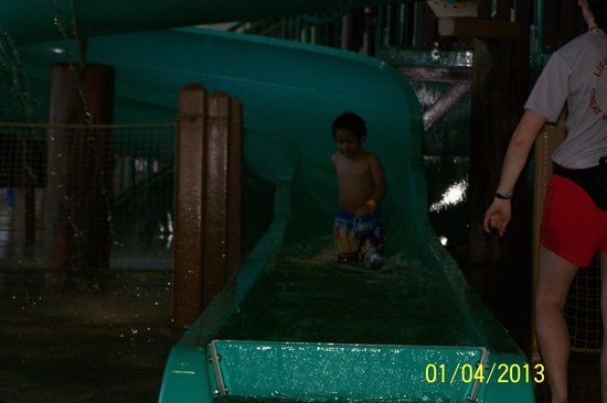 Great Wolf Lodge Water Park:                   Little guy coming down the big slide.  Feeling so proud of himself!