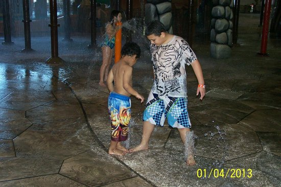 Great Wolf Lodge Water Park:                   Boys having fun with the water spouts.