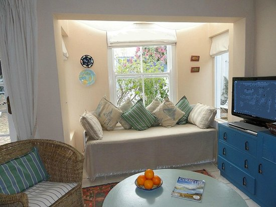 Eastbury Cottage: Garden Cottage by window and seating area