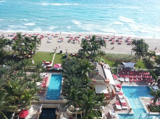 Acqualina Resort & Spa on the Beach:                   View from room's balcony of pools, beach and grille