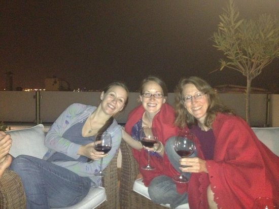 ‪هوتل ساري كوناك:                   enjoying wine on rooftop deck!