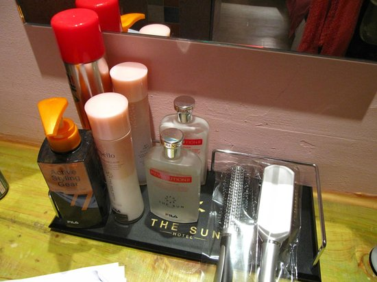 Hotel The Sun:                   Refillable lotions and hairsprays.